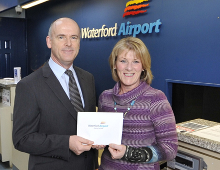 Lucky Mary Holden from Coolmore, Knocktopher, Co Kilkenny is pictured at Waterford Airport being presented with her prize of flights for four to London through London Southend Airport and £1000 spending money, Mary won the prize on the Waterford Airport facebook page and was presented with her prize by the Airports head of Air Traffic Control Donal Leahy – Photograph John Power.