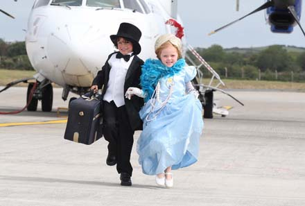 Pictured at Waterford Airport are Richie Hayes Stage School pupils Patrick O'Leary age 6 and Ella Hanamy age 5 celebrating the announcement of a new strategic partnership with Waterford Airport and Aer Arann as the Festival's new Official Airport Partner and Official Airline. Wexford Festival Opera goers receive 10% off the cost of their flights from London Southend, London Luton, Manchester and Birmingham direct to Waterford Airport. Wexford Festival Opera runs Saturday, October 21  through Saturday, November 5, 2011. www.wexfordopera.com - Photograph Patrick Browne
