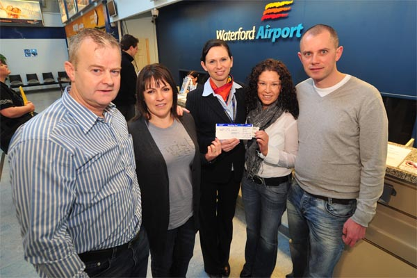 Alan and Dolores Reville with winners Tiffany and Jimmy Wickham Killinick Co. Wexford receiving their prize from Passenger Services Agent Lisa Cooke at Waterford Airport; the lucky four fly with Aer Arann from Waterford Airport to enjoy a fun weekend in Manchester having won the weekend away on a recent competition on South East Radio  – photograph John Power.